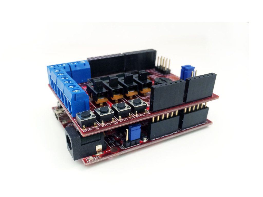 The Basic I/O Shield connects to the headers sitting on top of a chipKIT Uno32