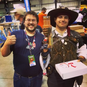 Me with a winner of the chipKIT Starter Kit + uC32 he runs a robotics team at his school and likes to dress up at Maker Faire!