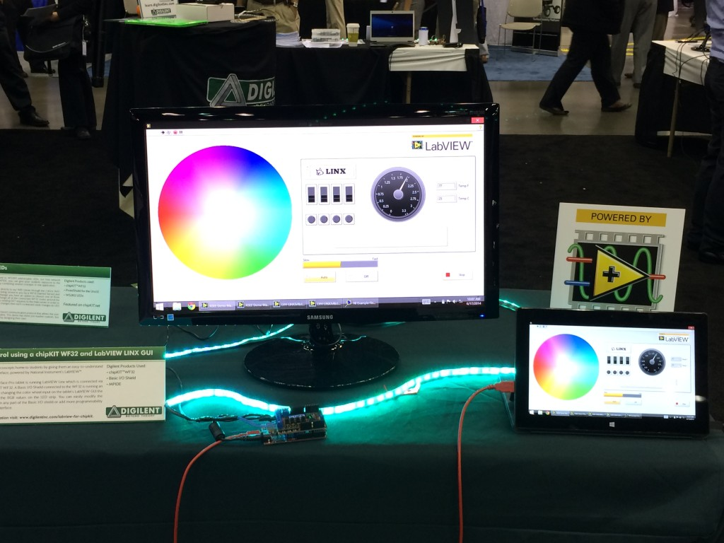 This demo featured the LabView Lynx connection that allowed a user to control the chipKIT basic I/O shield (connected to a WF32)  from the tablet (also displayed on the monitor). Users could interact with the Basic I/O shield through  LabView (rotate the potentiometer, vary the PWM for color mixing of the RGB LED Strip on the table and alter the logo on the OLED display). LabView--> Lynx--> MPIDE--> chipKIT--> Basic I/O Shield --> RGB LEDs