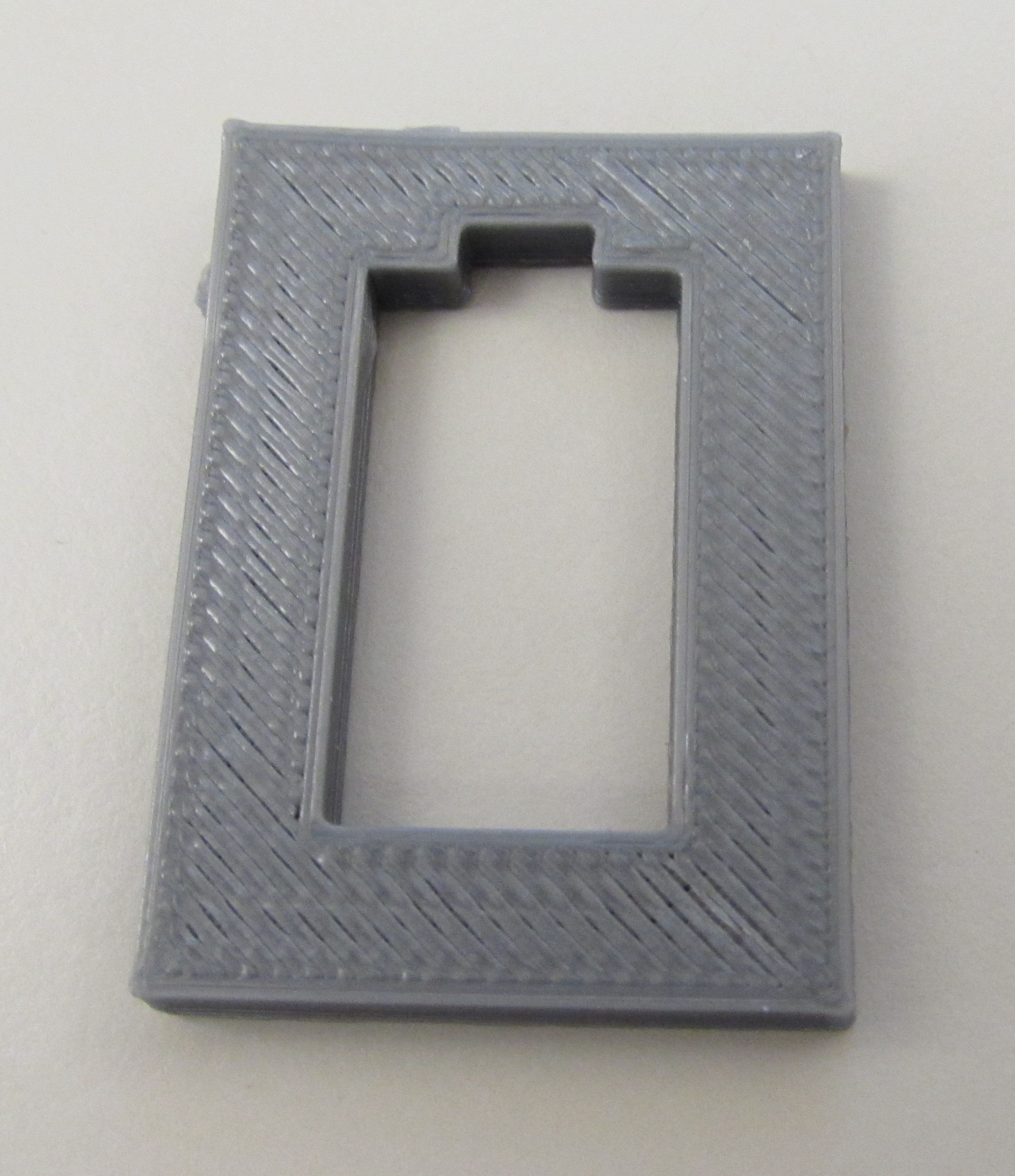 The screw holes lacked walls, making this print not watertight. So no screw holes were printed.