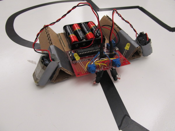Look at this handsome, cardboard, line-following robot!