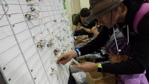 People trying out some circuits on our Breadboard Wall at Bay Area MakerFaire 2015