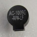 A small piezoelectric speaker.