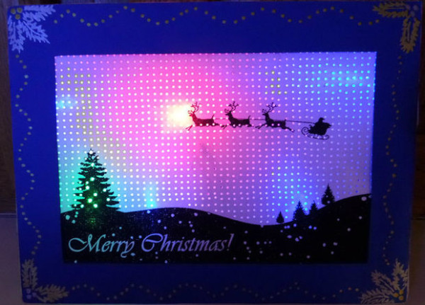 Have an LED back-lit pin hole Christmas card!