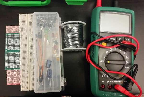 Things to troubleshoot electronics. A few breadboards, protoboard, wire and a Digital Muli Meter.