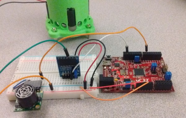 The setup of the more serious attempt with the microcontroller, the PmodMAXSONAR, the PmodOC1, and the fan holder.